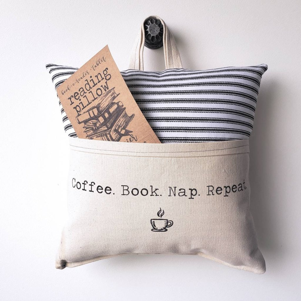 Striped pillow with pocket that says coffee book nap repeat