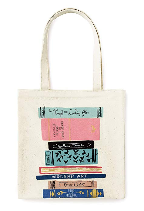 Canvas tote bag with a stack of books on it