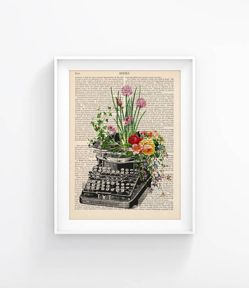 Vintage book page with print of a typewriter and flowers on top