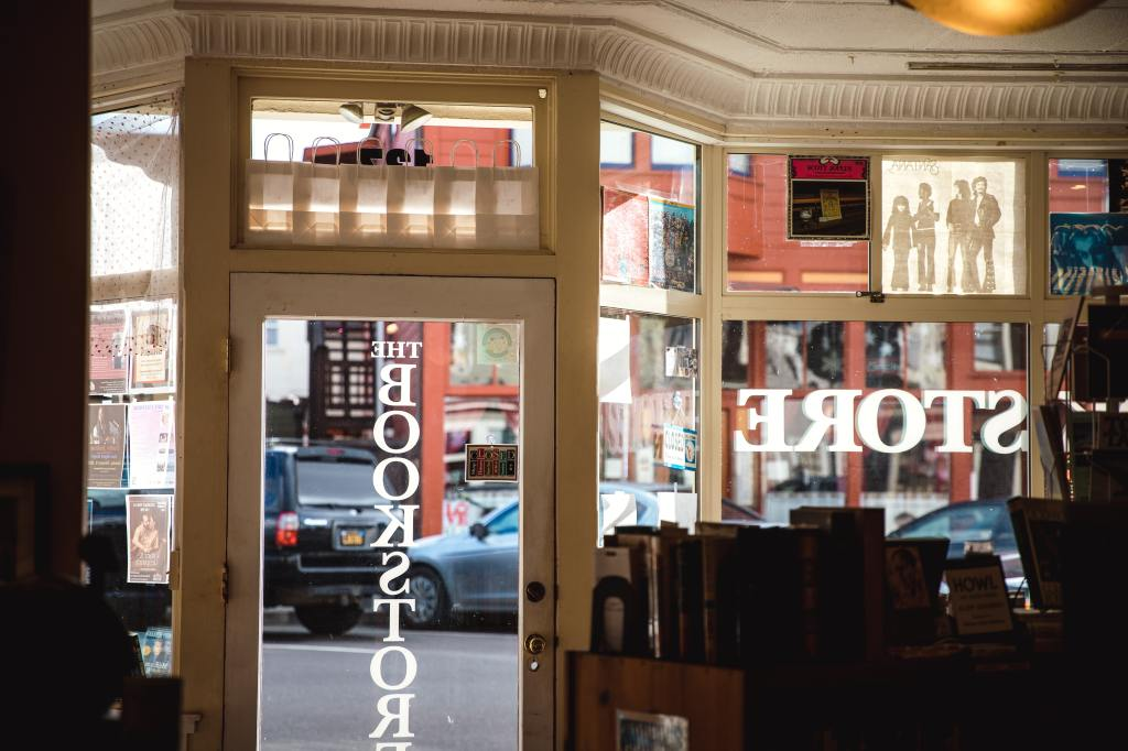 Inside of a bookstore looking out onto the street