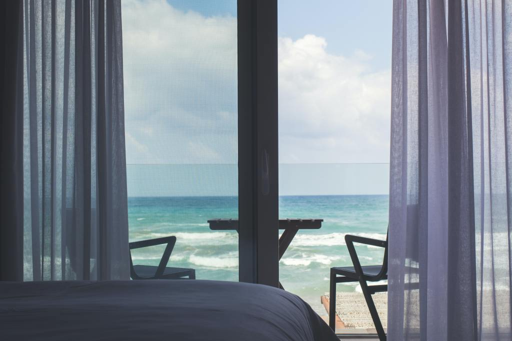 A beach view through a window